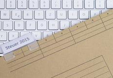 Налог 2015 клавиатуры и папки Стоковое фото RF
