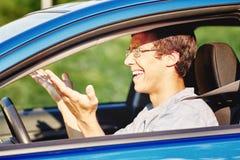 Надоеданный парень в автомобиле Стоковые Изображения RF