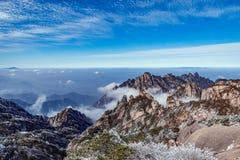 над пиками облаков Стоковая Фотография