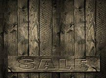 Надпись выгравированная ПРОДАЖЕЙ  деревянная предпосылка стоковые изображения