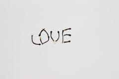 Надпись горящих спичек: влюбленность Стоковая Фотография
