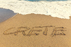 Надпись Крита на песке стоковое фото rf