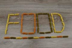 Надпись макаронных изделий покрашенных едой Стоковое Изображение RF