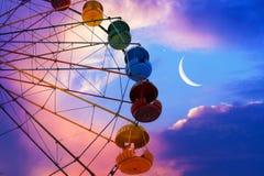 На предпосылке луны стоковая фотография