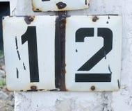 12 на плите metall Стоковая Фотография RF
