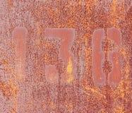 1, 3, 6 на ржавой железной стене. Стоковое фото RF