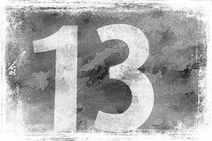 13 на серой стене Стоковое Фото