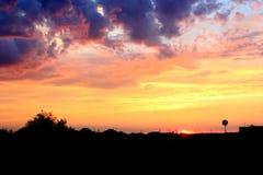 над селом захода солнца Стоковые Изображения RF