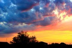 над селом захода солнца Стоковая Фотография