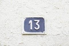 13 на стене в доме Стоковое фото RF