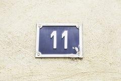 11 на стене дома Стоковые Фото
