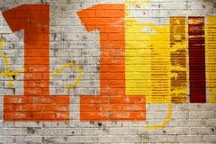 11 на стене Стоковое Фото