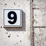 9 на стене Стоковое Фото