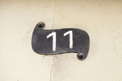 11 на стене Стоковое Изображение