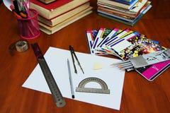 На таблице тетради с прописями стоковые фотографии rf