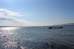 Небеса моря и затишья стоковые изображения