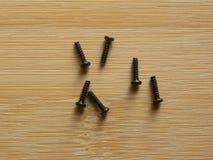 Небольшие черные винты металла стоковые фото