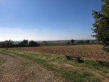 небо ландшафта травы поля предпосылки Стоковое фото RF
