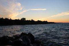 Небо захода солнца залива грузина оранжевое стоковые фотографии rf