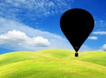 небо зеленого цвета поля воздушного шара Стоковое Изображение