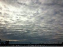 Небо, облака и снег Стоковые Изображения
