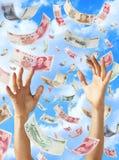 Небо рук китайских юаней денег падая Стоковое фото RF