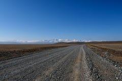Небо снега горы степи дороги Стоковые Изображения RF