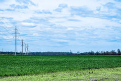 Небо с облаками над зелеными полями Стоковое Фото