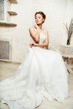 Невеста сидя на стуле Стоковая Фотография