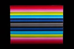 12 дневников другого цвета на черном стеклянном столе Стоковое Изображение RF