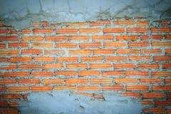 Незаконченная кирпичная стена штукатуря предпосылка с космосом экземпляра Und Стоковые Изображения