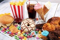 Нездоровые продукты неудача еды для диаграммы, кожи, сердца и зубов Стоковая Фотография