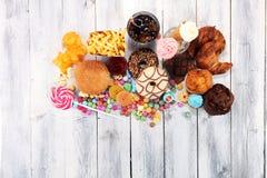 Нездоровые продукты неудача еды для диаграммы, кожи, сердца и зубов Стоковое Фото