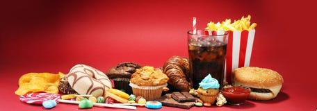 Нездоровые продукты неудача еды для диаграммы, кожи, сердца и зубов Стоковая Фотография RF