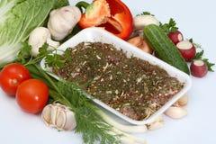 незрелые овощи приправой мяса Стоковая Фотография