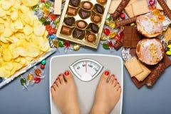 Нездоровая диета - избыточный вес Стоковое фото RF