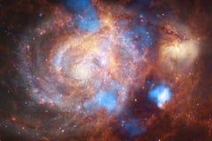 Неимоверно красивая галактика много световых год далеко от земли стоковое изображение