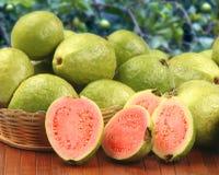 Некоторые бразильские guavas над striped поверхностью Стоковое Изображение