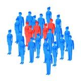 Некоторые красные равновеликие люди стоя среди голубой толпы Стоковая Фотография