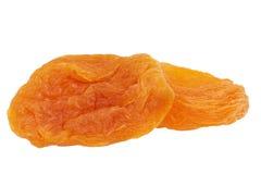Некоторые плодоовощи высушенного абрикоса изолированного на белой предпосылке Стоковая Фотография RF