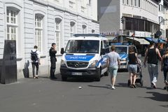 Немецкая полиция на патруле стоковое изображение rf