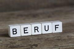 Немецкая профессия слова, написанная в кубах Стоковая Фотография
