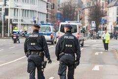 Немецкие полицейскии и автомобили Стоковое Изображение RF