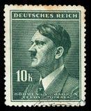 НЕМЕЦКИЙ РЕЙХ Около 1939 - c 1944: Штемпель почтового сбора с портретировать Адольфа Гитлера стоковое фото