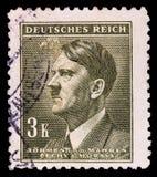 НЕМЕЦКИЙ РЕЙХ Около 1939 - c 1944: Штемпель почтового сбора с портретировать Адольфа Гитлера стоковое изображение