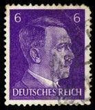 НЕМЕЦКИЙ РЕЙХ Около 1939 - c 1944: Штемпель почтового сбора с портретировать Адольфа Гитлера стоковые изображения rf