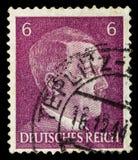НЕМЕЦКИЙ РЕЙХ Около 1939 - c 1944: Штемпель почтового сбора с портретировать Адольфа Гитлера стоковые изображения
