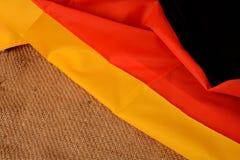 Немецкий флаг на предпосылке джута Стоковая Фотография RF