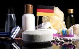 Немецкий флаг в мыле с всеми продуктами для hyg людей Стоковые Изображения RF