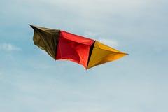 Немецкое летание змея в голубом небе Стоковая Фотография RF